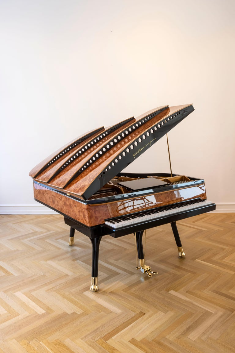 - All prices are listed ex works. - 5 year guarantee. - We regularly crate, ship and install PH Pianos worldwide with full insurance.  This gorgeous new PH Bow Grand Piano, finished in American Red Maple Burl, is an incredible instrument first