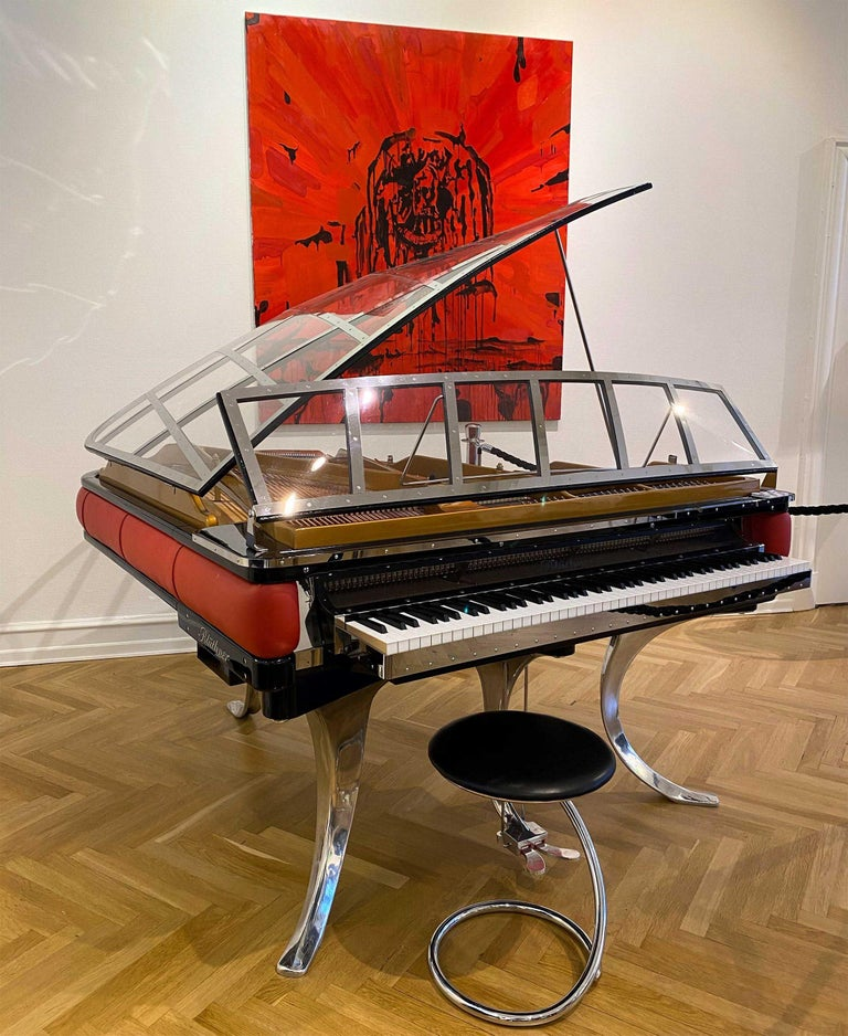 - All prices are listed ex works. - 5 year guarantee. - We regularly crate, ship and install PH Pianos worldwide with full insurance.  This PH Grand Piano is crafted in 2018 and is a total eye catching icon with the red leather rim and high