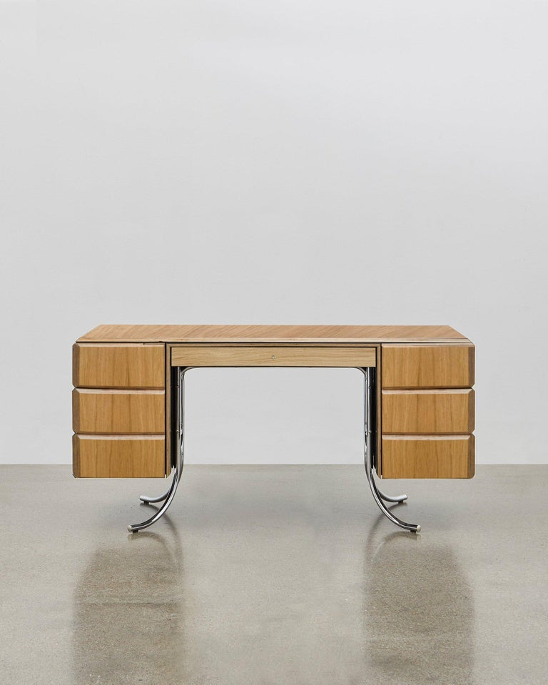 Bold and colorful, this desk will add style and character too your working day. Poul Henningsen designed this masterpiece in 1935. A harmony of striking aesthetics and practicality, PH's design features a desktop painted in high gloss, six swing