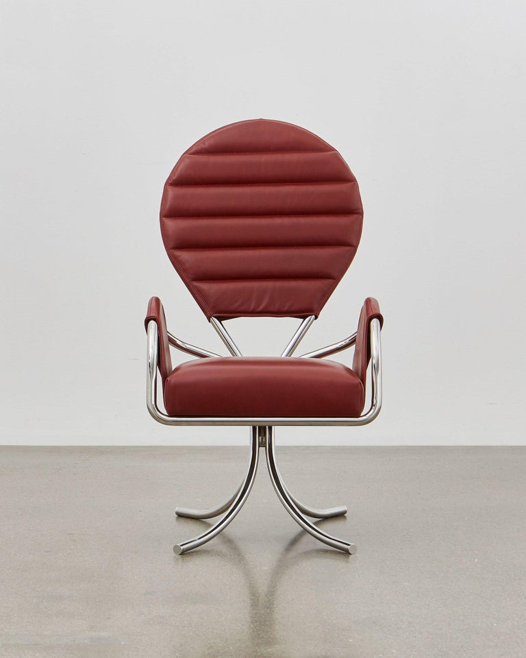 The traditional Pope's hat provided the inspiration for the shape of the chairs back, which is noted for its superior support and comfort.   The Pope Chair is designed in 1932 and is a clear statement that fits so well into all settings, whether