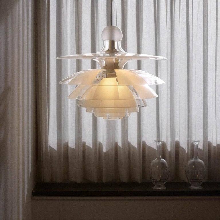 The PH Septima is regarded as one of Poul Henningsen's most refined pendants. When exhibited for the first time as a prototype at the Danish Museum of Decorative Art (now Designmuseum Danmark) in 1928, the poetic piece was publically applauded. The