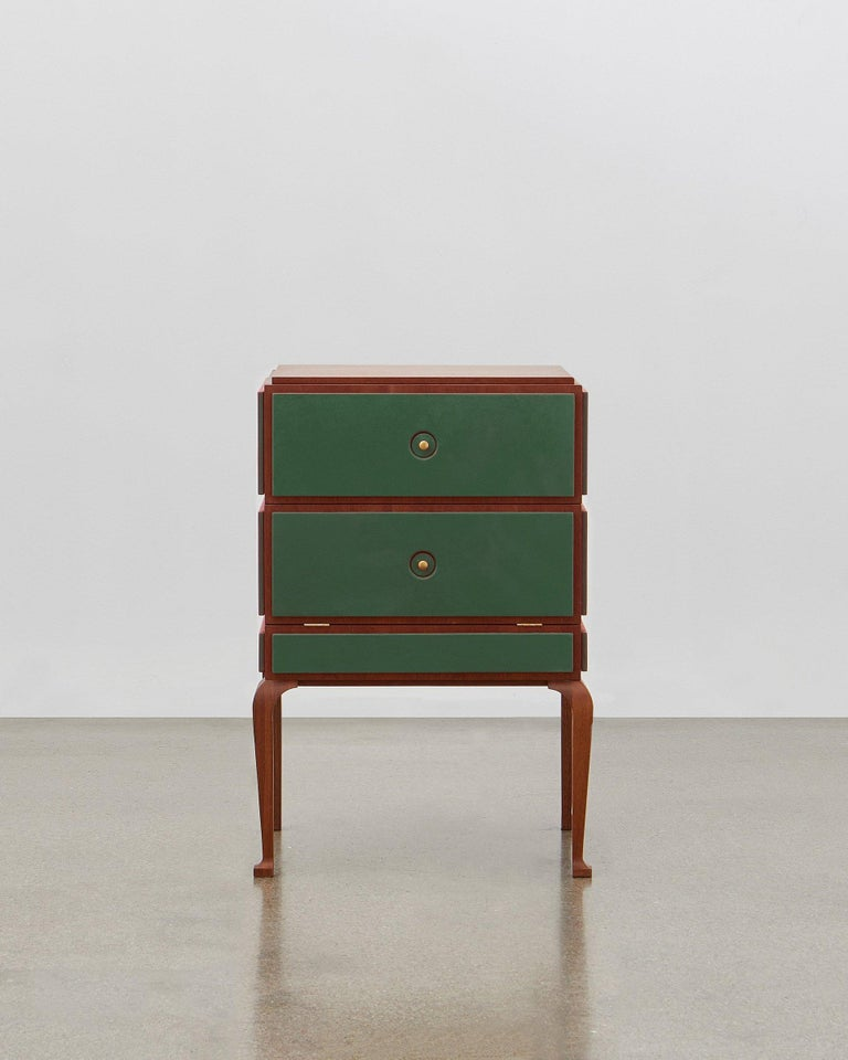 This small but perfectly formed storage piece is made out of wood and can be combined with soft leather on the panels.   It is elegant and stylish all the way around and from all angles. Poul Henningsen designed this in 1920.  The PH small