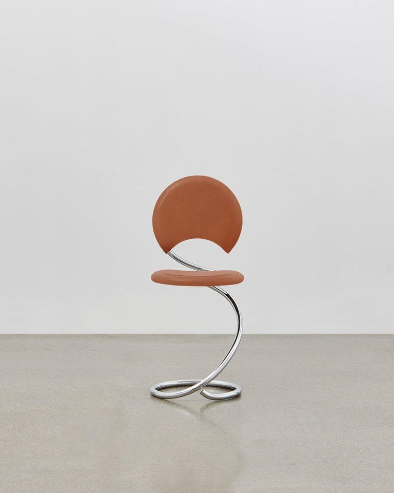 The PH snake chairs flowing lines within its steel tube design are inspired by the strong yet flexible body of a snake. It is multi-use and fits any room at home, in the apartment, in the office, with a function or simply as a piece of art to be