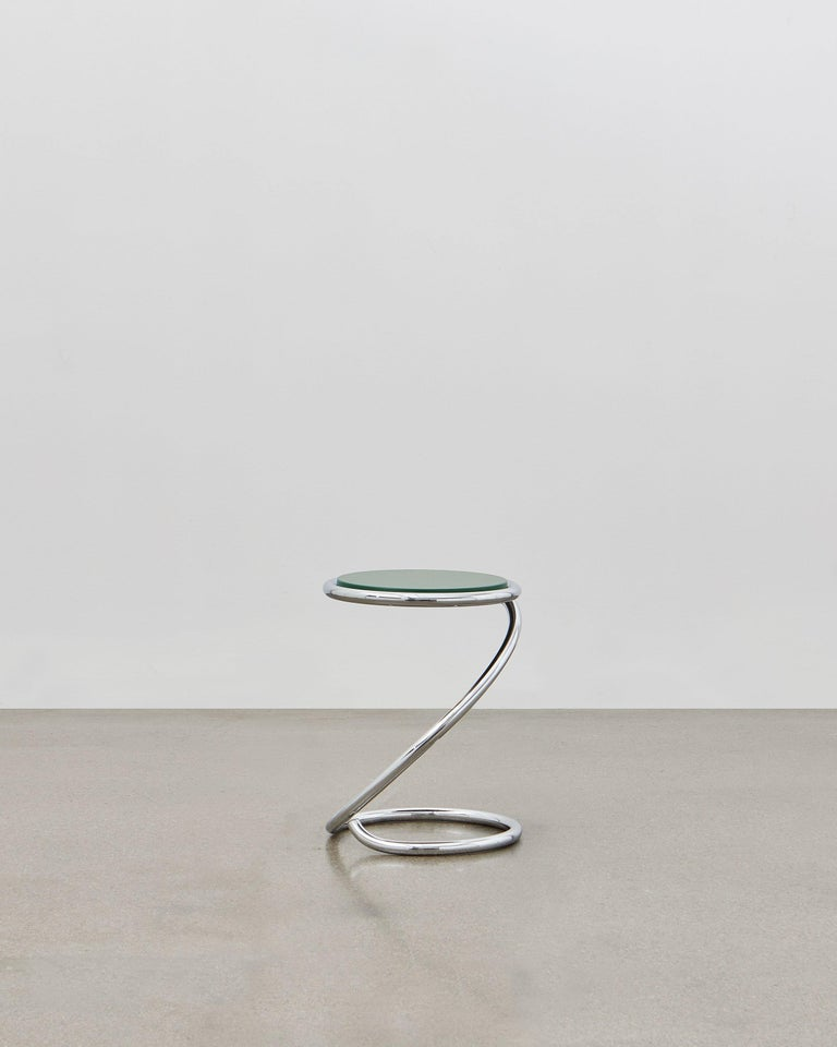 The PH snake stool is completely true to the original design and the use of chromed steel tubes, however updated for the 21st century to be available with wood seating in five colorways to coordinate with the ever-popular Poul Henningsen lighting