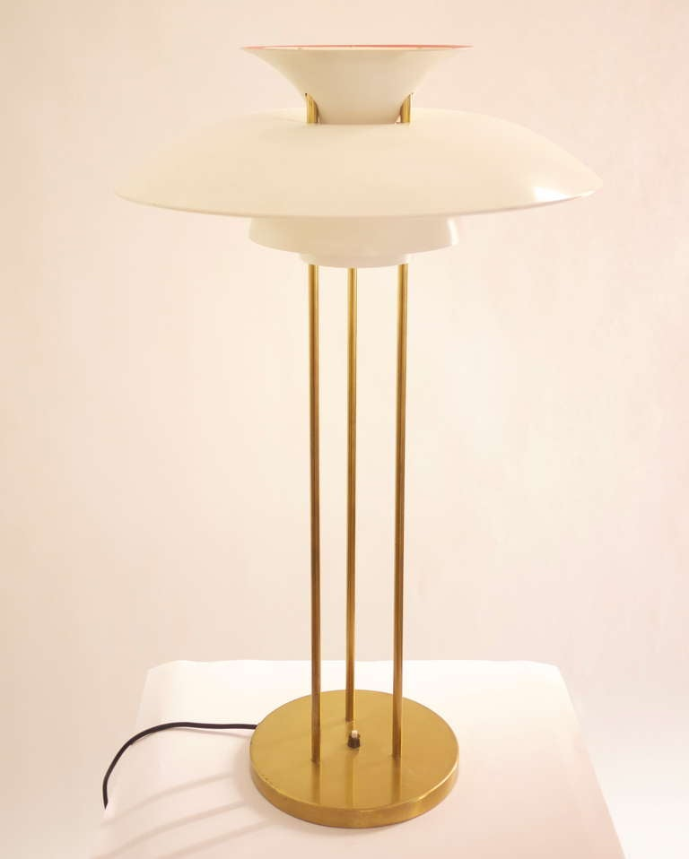 A PH5 table lamp designed by Poul Henningsen in 1927 and edited by Louis Poulsen in 1970s. Three brass legs, brass base and white painted metal shades. Impeccable conditions. No longer produced.