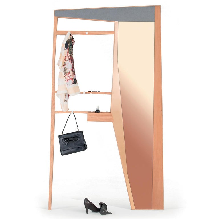 Sophisticated and modern, this multifunctional piece comprises a rectangular frame in dark grey and pear wood that encloses two distinctive elements: an entryway wardrobe with two hooks as coat hangers and three shelves as vide-poche, and an