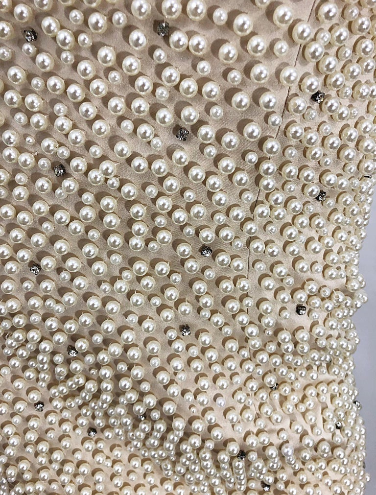 Phenomenal vintage 90s pearl and rhinestone encrusted couture bodycon gown! Features thousands of  hand-sewn pearls and rhinestones throughout. Built in interior support keeps everything in place. Nude chiffon overlay at legs. Couture quality with