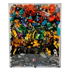Phenomenal Collection of Toys Encased in a Lucite Box by J. Santamarina