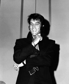 Elvis Laughing at a Press Conference