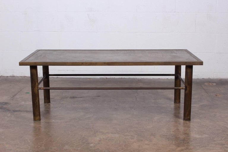 A bronze Chan coffee table designed by Philip and Kelvin LaVerne.