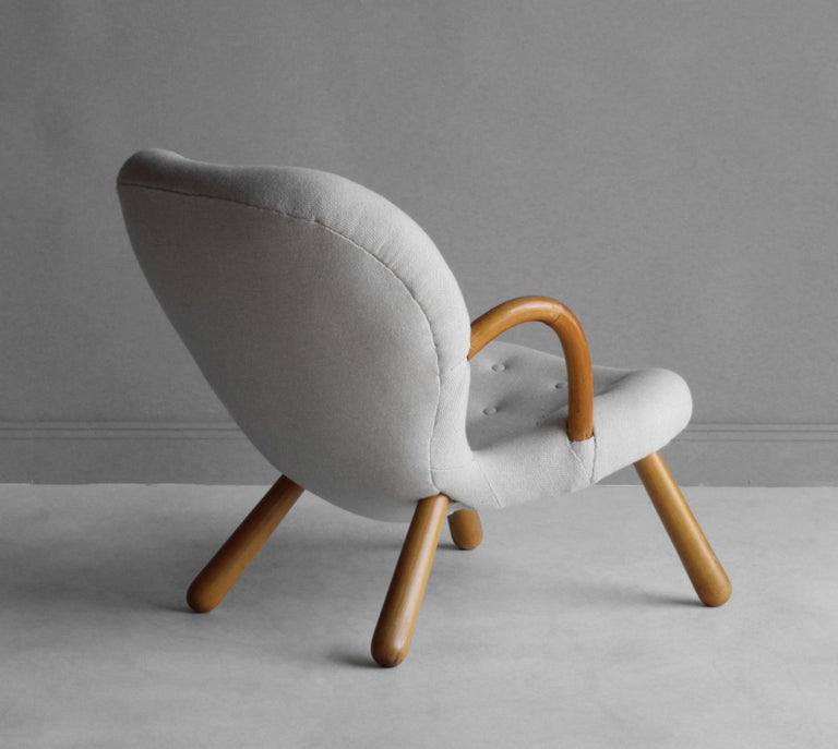 An organic Philip Arctander lounge chair or clam chair. Stained beech frame, upholstered in a traditional Scandinavian fabric.  Other 20th century designers working in the organic style include Flemming Lassen, Gio Ponti, Vladimir Kagan, Jean