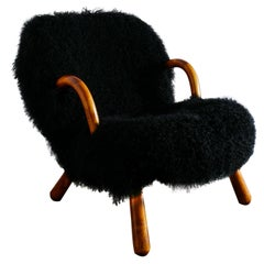 """Philip Arctander """"Clam Chair"""" in Black Curly Sheepskin, 1940s"""