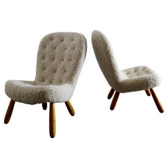 """Philip Arctander Pair of """"Clam Chairs"""" in Sheepskin Produced in Denmark, 1940s"""