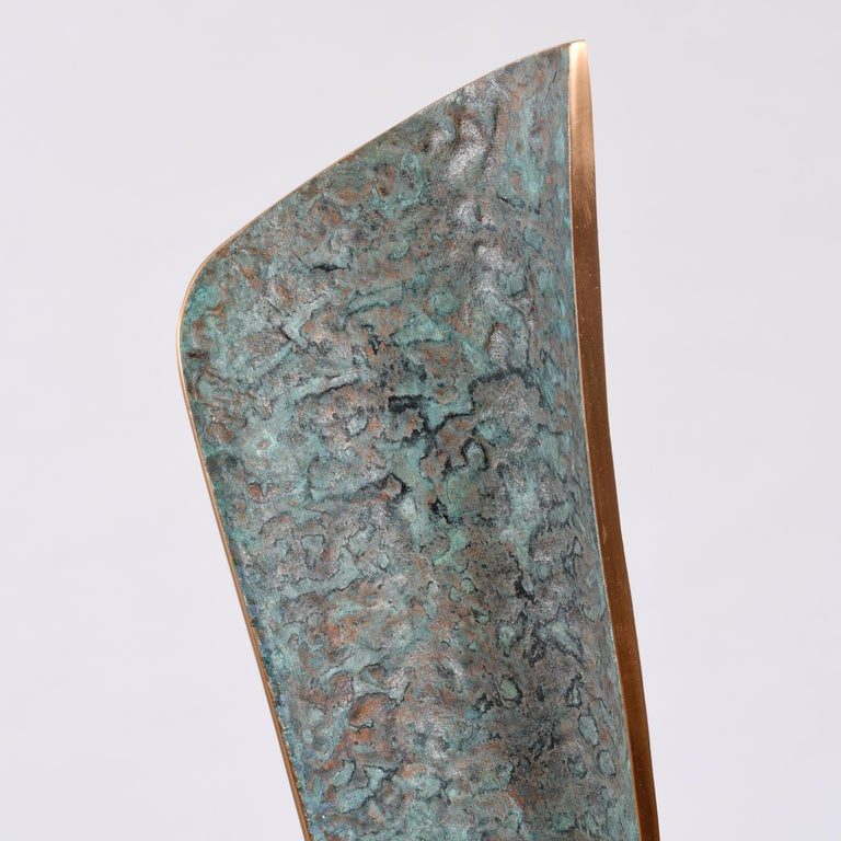 Bronze on an oak base Series of individual variations Stamped with monogram signature and uniquely numbered 609A The heavily textured inner surface is colour-washed over oxidisation. The edges expose the natural bronze and are lacquered for