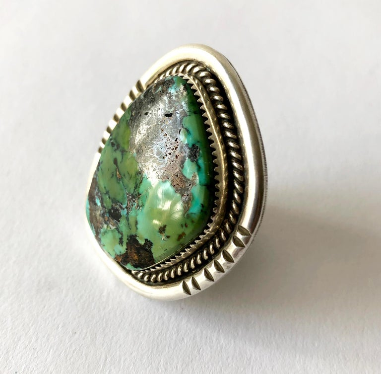 Hefty sterling silver and turquoise ring by Native American jeweler Philip Morse.  Ring is a finger size 11.5 - 12, the face of the ring measures 1.75