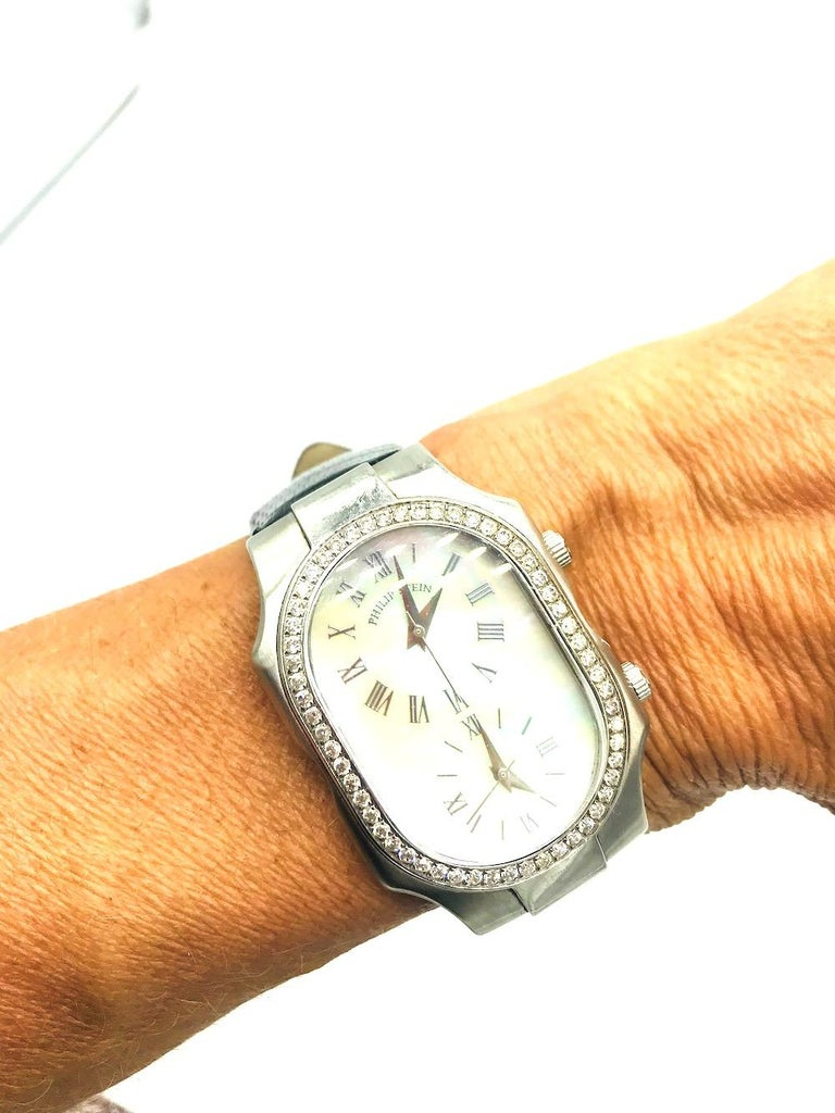 Philip Stein Signature Watch. Diamond 2-Time Zone Watch VS quality diamonds. Mother of Pearl Dial. Black original strap, 9.5 inch total length. Face of watch is 2 inches x 1 -1/2 complete Genuine Lizard strap. Water resistant to 3 ATM. Feel Good