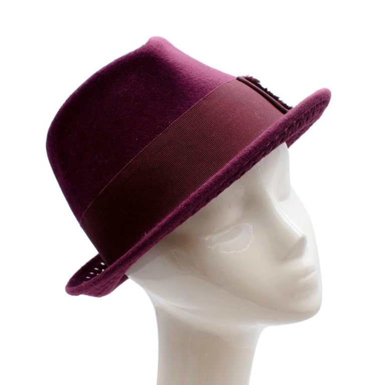 Philip Treacy Burgundy Wool Felt Trilby Hat  - Luxurious soft wool felt texture - Grosgrain ribbon hat band with fringe details  - Unicorn pin logo to the side - Pinched crown - Beautiful burgundy hue  - Perforated details to the edge  - Fully lined