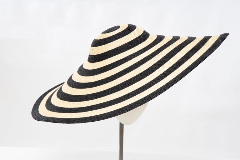 Philip Treacy for Ralph Lauren Collection, striped raffia wide-brim hat with inserts at interior and tonal stitching.  Circumference: 21