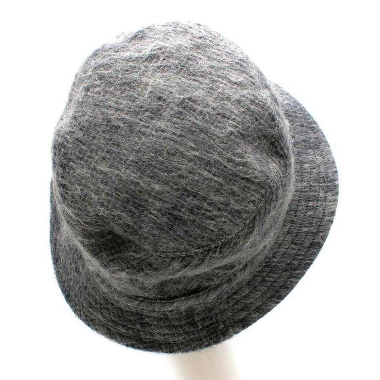 Philip Treacy Grey Wool Blend Bucket Hat  - Bucket hat style - Wool blend soft fur like texture - fully lined - Philip Treacy silver-tone unicorn embellishment   Materials Wool blend  Made in England   Across  28cm  Height 14cm
