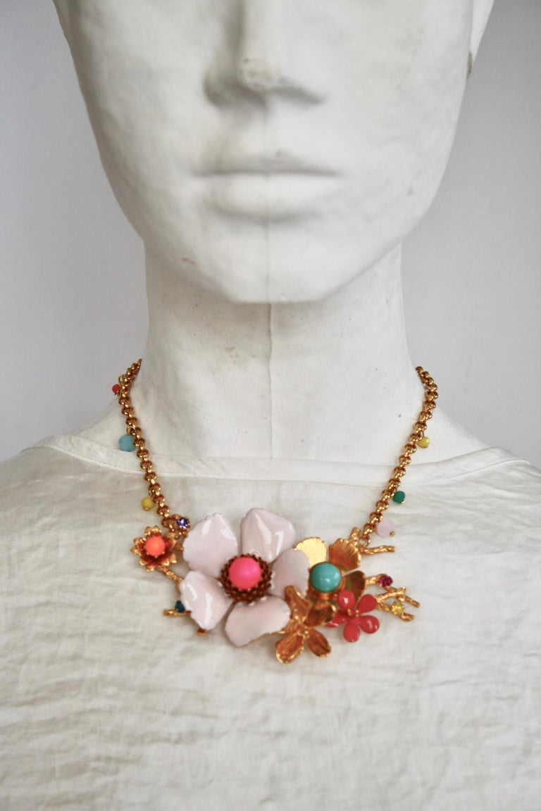 Floral motif necklace made with enamel and glass cabochons from French design house Philippe Ferrandis.