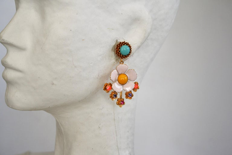 Floral motif pierced earrings made with enamel and glass from Philippe Ferrandis.