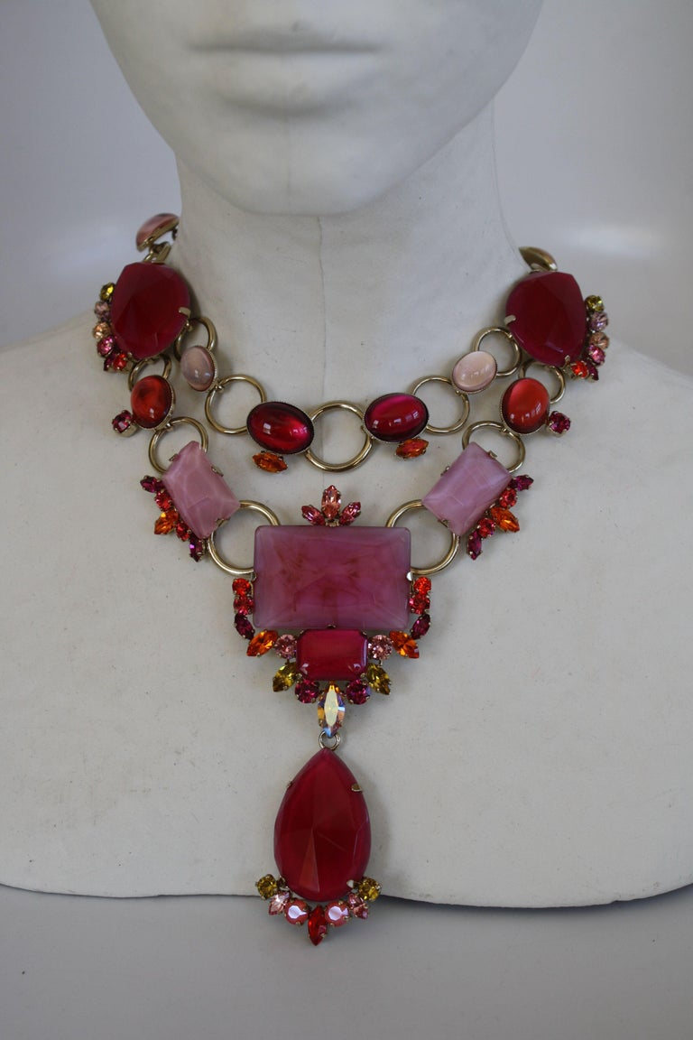 Statement necklace made from Swarovski Crystals and glass in shades of pink and fuchsia. Drop is 4