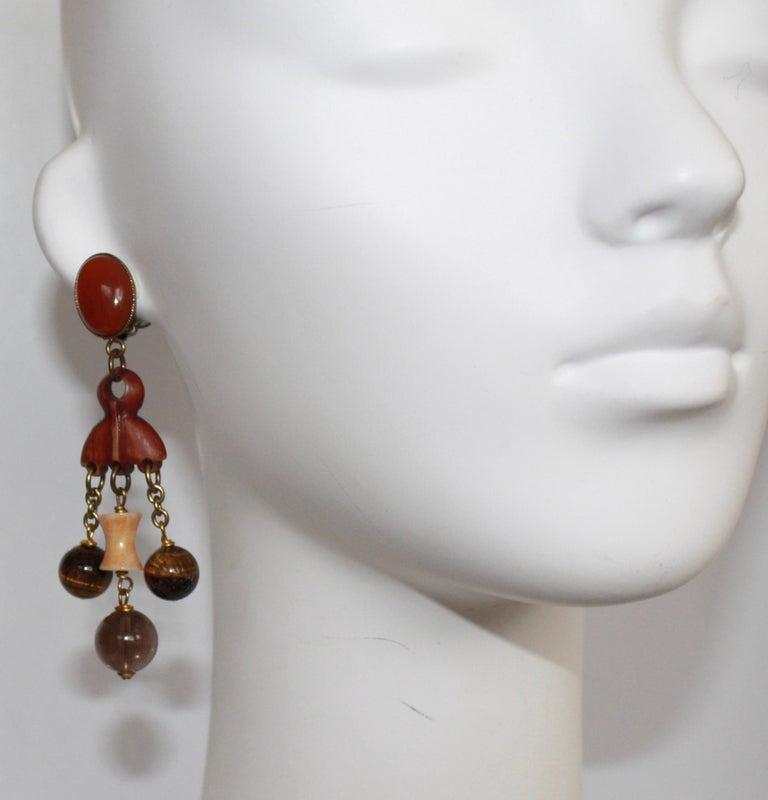 Handmade glass cabochons, wood, rhodium metal. Clip earrings