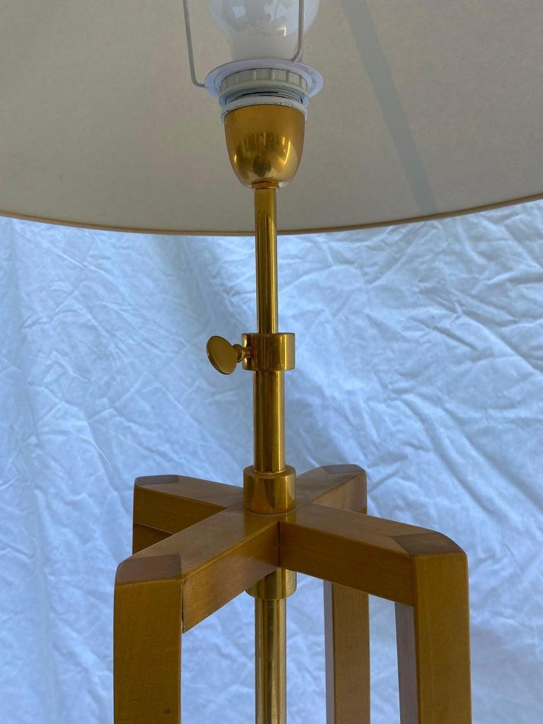 Philippe Hurel - Quadripod floor lamp Circa 2000  Wood and brass  Measures: H 146 x D 50 cm.