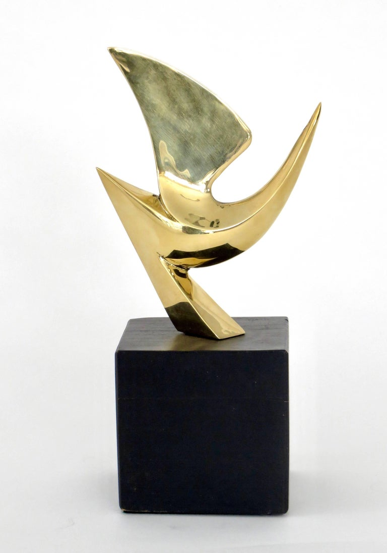 A cast bronze bird sculpture by Philippe Jean, French artist, designer and sculptor.  Mounted on a black wood cube base.  Signed and numbered. PhJean 85/300 A Classic motif for the artist. Total height with base is 9.5