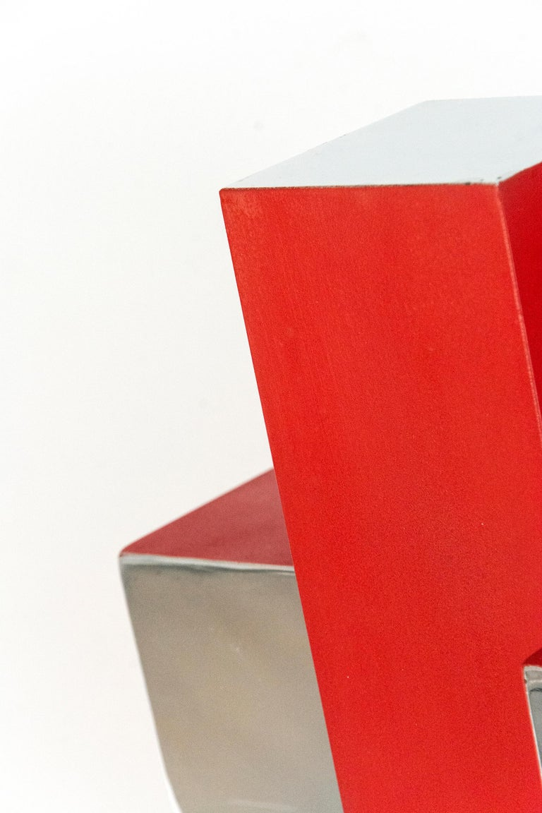 Intersecting geometry in poppy red and polished aluminum form a dynamic whole in this modern sculpture by Philippe Pallafray. This work is number 1 in an edition of 10.  Philippe Pallafray (b. 1965, France) is a member of the Sculptors Society of