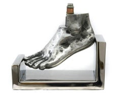 Foot - Stainless stylized table top sculpture of an angled foot