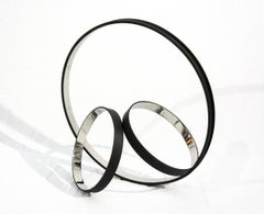 Temps Zero Black 6/10 - stainless steel, rings, table-top, abstract, sculpture