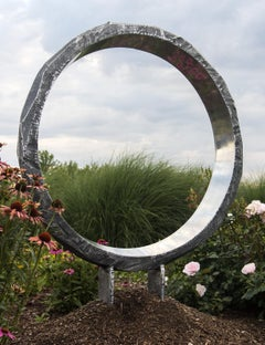 Wormhole - elegant, polished, reflective stainless steel ring, outdoor sculpture