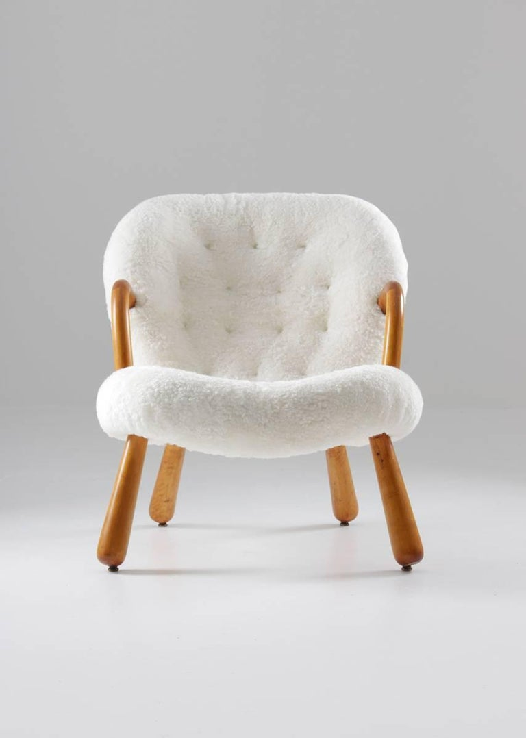 Clam chair by Filip Arctander, produced by Nordisk Staal & Møbel Central, Denmark.  Condition: Excellent, fully restored wood and frame and reupholstered.