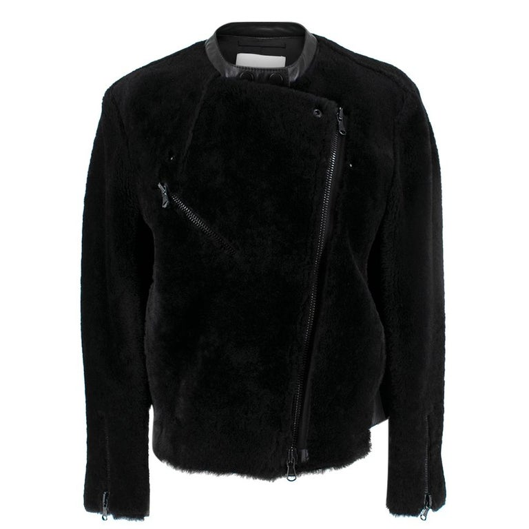 Phillip Lim Motorcycle Jacket with Fur and Leather Panelling  -Motorcycle jacket with fur exterior design -Zip cuff closure -Leather panelling   -Black lining  -Leather trim   -One exterior zip pocket  -Central zip closure  -Black hardware -Two