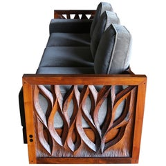Phillip Lloyd Powell Hand Carved American Black Walnut Sofa, circa 1969