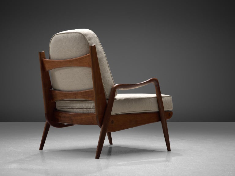 Philip Lloyd Powell, New Hope lounge chair, American walnut and off-white velvet, United States, 1960s.   This sculptural armchair executed in American walnut and fabric upholstery is designed by Philip Lloyd Powell. The name 'New Hope' is a