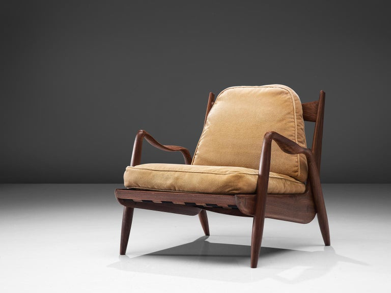 Philip Lloyd Powell, new hope lounge chair, American walnut and beige velvet, United States, 1960s.  This sculptural armchair executed in American walnut and velvet upholstery is designed by Philip Lloyd Powell. The name 'New Hope' is a reference