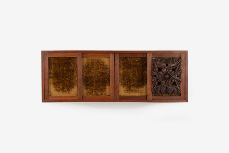 Phillip Lloyd Powell wall hanging cabinet, oiled American black walnut case with 4 sliding doors 3 covered in velvet one Palazzo architectural element that Phil sourced in Italy. Can also be used as a wall hung console.
