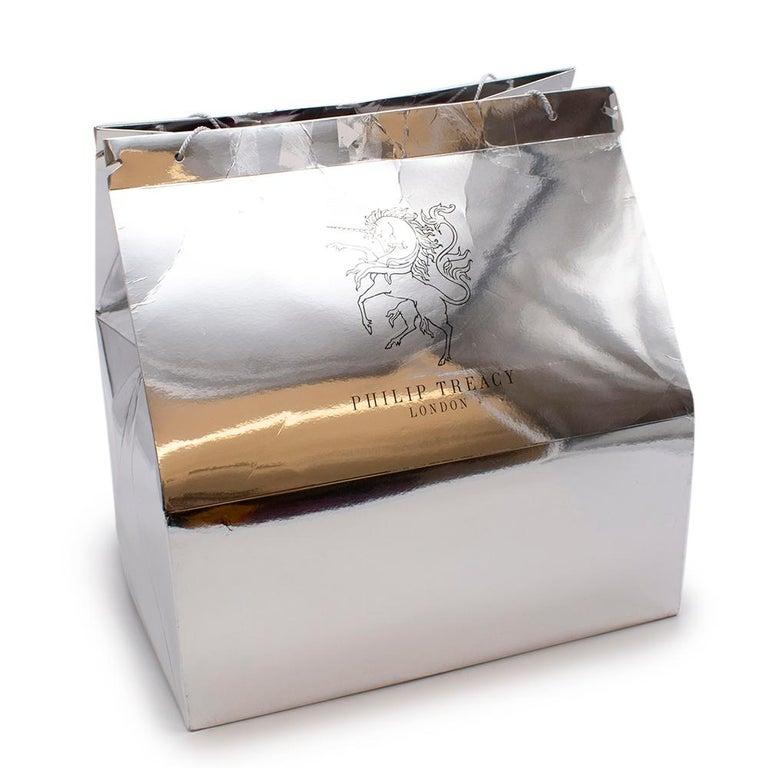 Philip Treacy Purple Parasisal Hat  - Elegant magenta parasisal base hat  - Handmade front curl  detailing  - Satin lined interior  - Inner padding  - Original bag include  Materials: 100% Natural Straw   Made in UK   Circumference - 72.5cm Height -