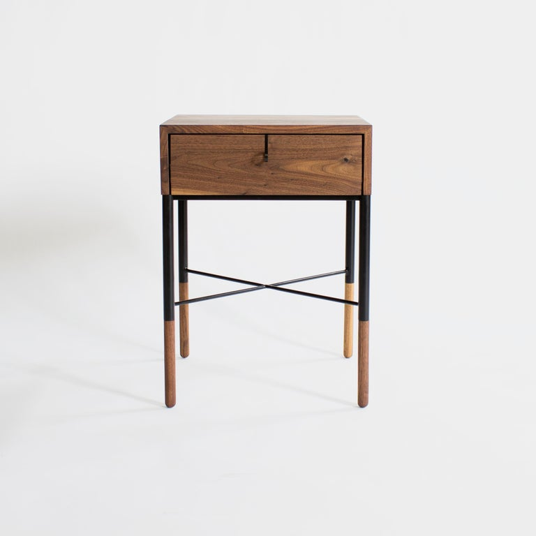 Phillip Nightstand  by Crump and Kwash   Solid wood case with continuous waterfall grain / blackened steel pulls and base / hand shaped walnut feet / natural oil finish.  Wood Options - Walnut, White Oak, Maple, Black Oak   Customizations Available