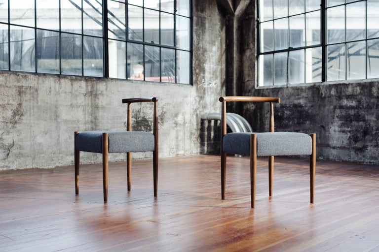 Phloem Studio Harbor chair is a modern contemporary solid wood side chair handmade custom to order with turned tapered and shaped legs and tube back shaped from hardwood by hand and an upholstered seat. Appropriate as both a dining chair or