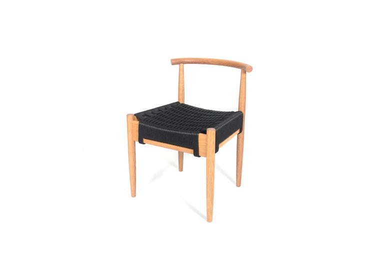 Phloem Studio Harbor chair is a modern contemporary solid walnut wood side chair handmade custom to order with turned tapered and shaped legs and tube back shaped from hardwood by hand. Appropriate as both a dining chair or occasional chair for