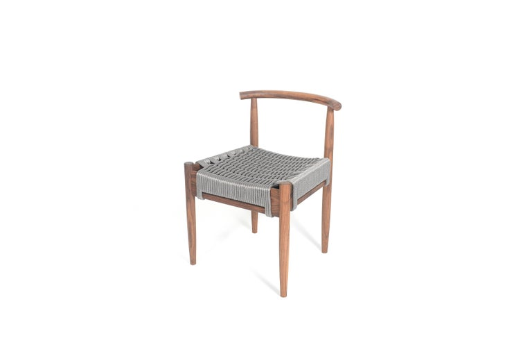 Phloem Studio Harbor chair is a modern contemporary solid wood white oak side chair handmade custom to order with turned tapered and shaped legs and tube back shaped from hardwood by hand. Appropriate as both a dining chair or occasional chair for