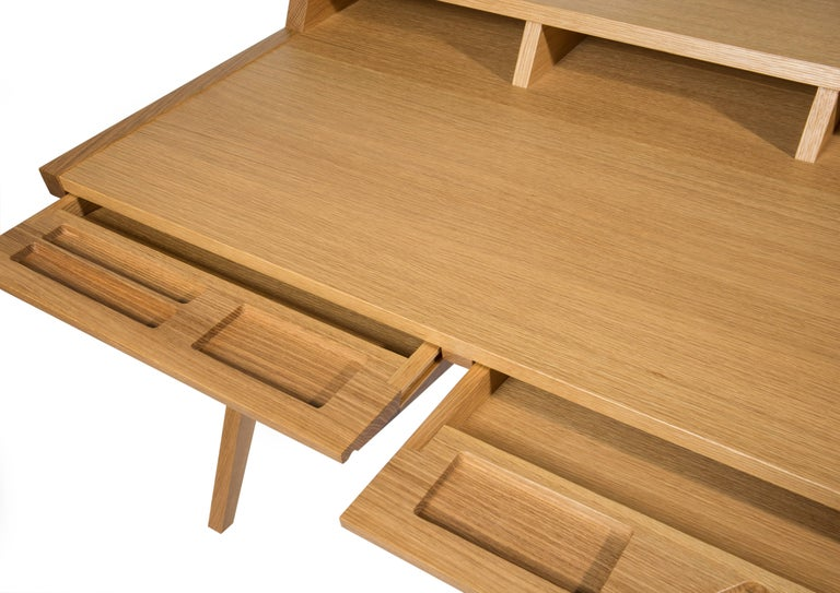 Phloem Studio Laura desk is a modern contemporary solid wood secretary desk, handmade custom to order for home or office. With a minimal footprint, the table has ample surface for a laptop and writing space. The desk has two tapered tray drawers