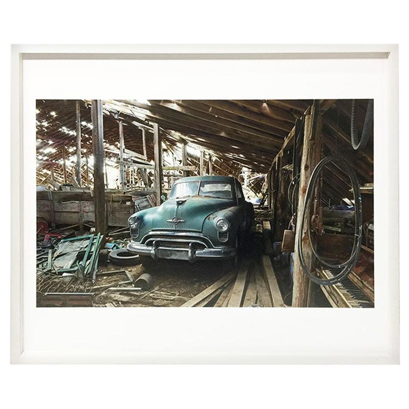 """Photograph by Andrew Moore""""Olds in the Sheep Barn, Sioux County, Nebraska, 2014"""""""