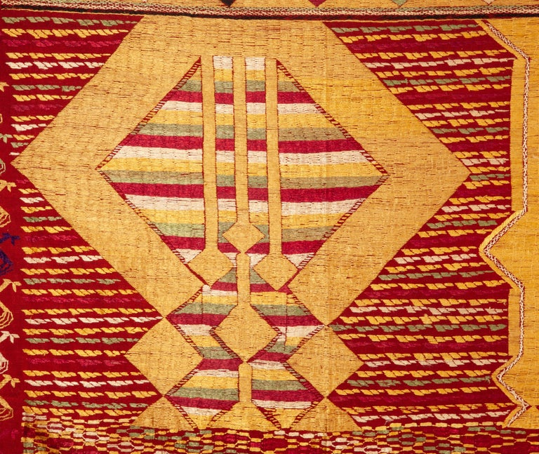 A rare pattern embroidered in silk on a hand loomed cotton background.