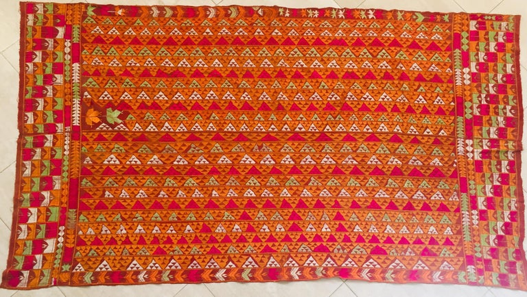 A rare pattern embroidered in silk on a hand loomed cotton background. Punjab is known for its Phulkaris. The embroidery is done with floss silk thread on coarse handwoven cotton fabric. Geometrical patterns are usually embroidered on the Phulkaris.