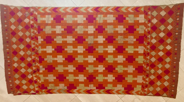 A rare pattern embroidered in silk on a hand loomed cotton background. Punjab is known for its Phulkaris. The embroidery is done with floss silk thread on coarse handwoven cotton fabric. Geometrical patterns are usually embroidered on the