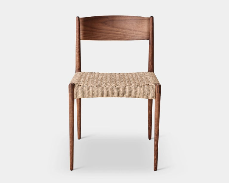 PIA chair Solid oak frame, paper cordel seat Dimensions: H 75 x 49 x 48 cm (seat height 45cm)  Wood: – Oak – Smoked oak – Black lacquered oak – Walnut  Paper cordel: – Natural – Black (Contact us)  -- The Pia chair signed by DK3 was